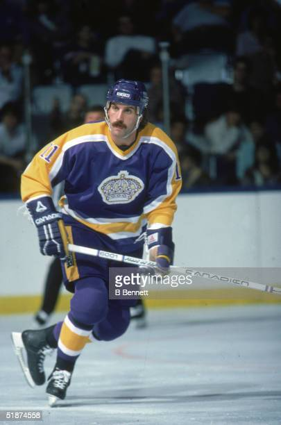 Canadian hockey player Charlie Simmer of the Los Angeles Kings on the ice during a game against the New York Islanders at Nassau Coliseum Uniondale...