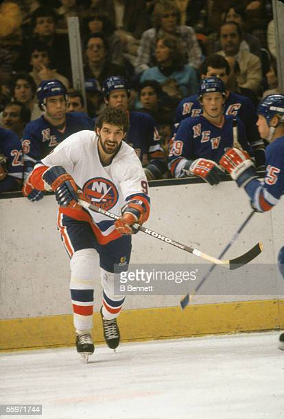 Canadian hockey player Clark Gillies of the New York Islanders skates on the ice during a game against the New York Rangers New York December 1982