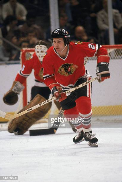 Canadian hockey player Cliff Koroll of the Chicago Black Hawks skates up the ice during a game against the New York Islanders at Nassau Coliseum...
