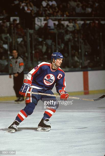 Canadian hockey player Dale Hawerchuk of the Winnipeg Jets on the ice during a road game. 1980s.