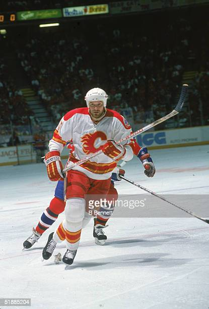 Canadian hockey player Dana Murzyn of the Calgary Flames skates on the ice during a Stanley Cup championship game against the Montreal Canadiens at...