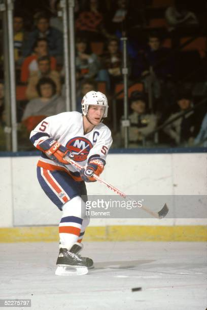 Canadian hockey player Denis Potvin of the New York Islanders passes the puck during a home game at Nassau Coliseum Uniondale New York 1980s