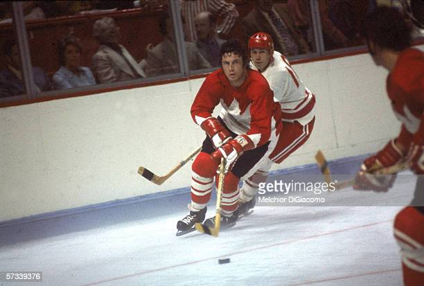 Canadian hockey player Don Awrey keeps the puck away from a Russian player hot on his heels during a 1972 Summit Series game September 1972