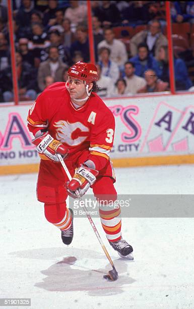Canadian hockey player Doug Gilmour of the Calgary Flames skates with the puck during a game against the Philadelphia Flyers at The Spectrum...