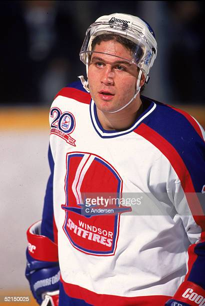 Canadian hockey player Ed Jovanovski of the Windsor Spitfires of the Ontario Hockey League skates with his facemask tipped back 1994