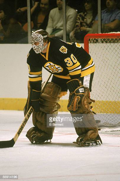 Canadian hockey player Gerry Cheevers, goalkeeper for the Boston Bruins, guards the net during a road game, 1979 or 1980.