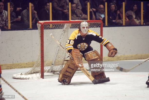 Canadian hockey player Gerry Cheevers, goalkeeper for the Boston Bruins, guards the net during a game at Madison Square Garden, New York, New York,...
