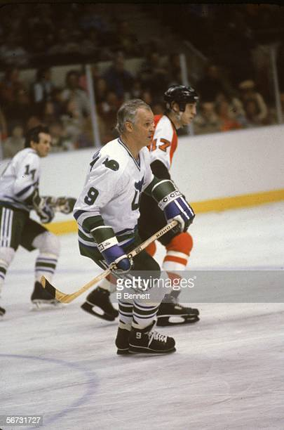 Canadian hockey player Gordie Howe of the Hartford Whalers skates up the ice with teammate Dave Keon and opponant Paul Holgren of the Phildaelphia...