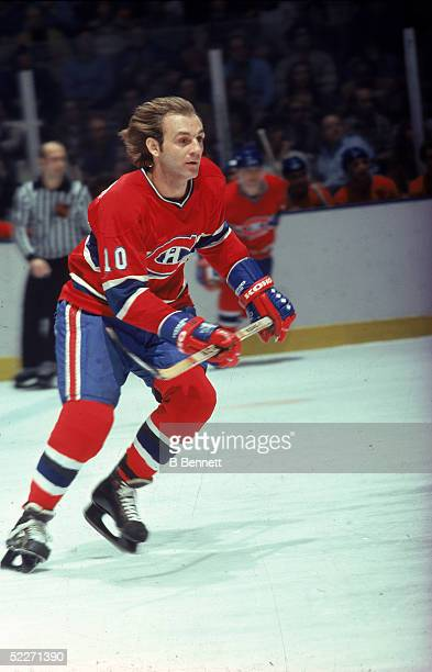 Canadian hockey player Guy Lafleur in the uniform of the Montreal Canadiens skates up the ice during a road game late 1970s or early 1980s