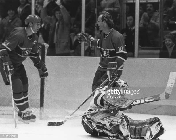 Canadian hockey player Guy Lafleur of the Montreal Canadiens celebrates his 500th career goal with his teammate Bob Gainey while New Jersey Devils...