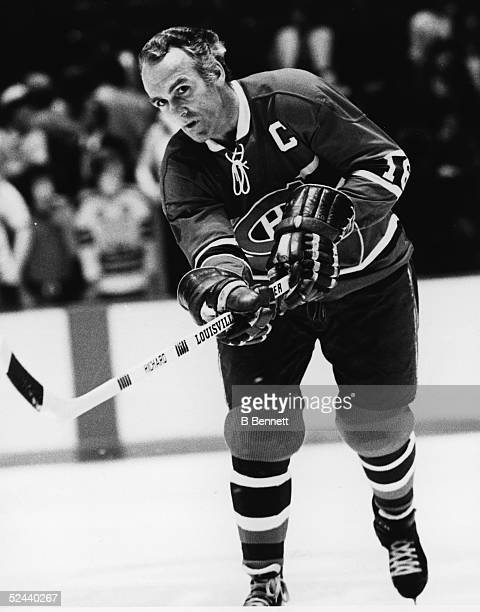 Canadian hockey player Henri Richard of the Montreal Canadiens passes the puck during a game late 1960s or early 1970s