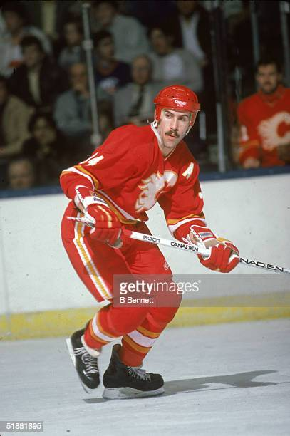 Canadian hockey player Jamie Macoun of the Calgary Flames keeps an eye on the action during a game against the New York Islanders at Nassau Coliseum,...