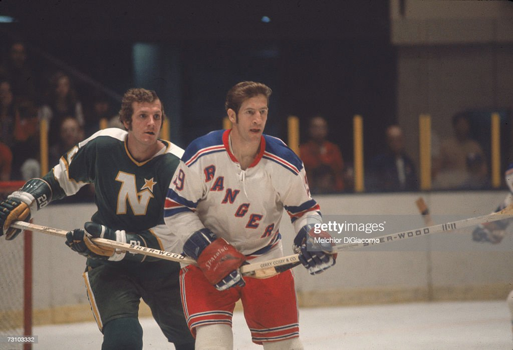 Canadian hockey player Jean Ratelle (right) of the New York Rangers on the ice during a game against the Minnesota North Stars, February 1972.