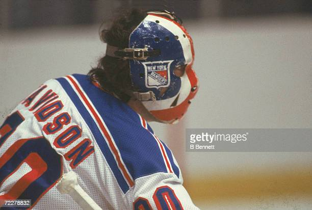 Canadian hockey player John Davidson goalkeeper for the New York Rangers on the ice during a game late 1970s or early 1980s