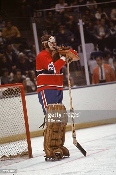 Canadian hockey player Ken Dryden goalkeeper for the Montreal Canadiens leans on his stick in front of the net during a pause in a road game 197Os