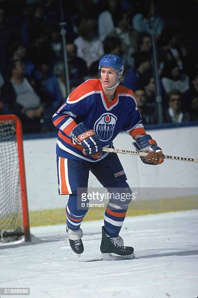 Canadian hockey player Kevin Lowe, defenseman for the Edmonton Oilers, plays in a road game at Nassau Coliseum, Uniondale, New York, late 1980s.