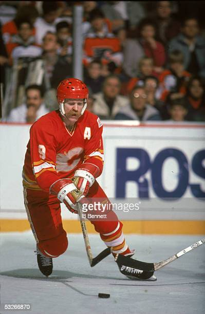 Canadian hockey player Lanny McDonald of the Calgary Flames reaches for the puck during a game 1980s