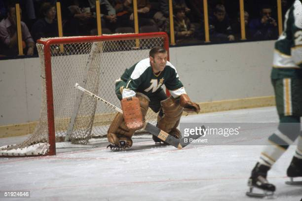 Canadian hockey player Lorne 'Gump' Worsley, goalie for the Minnesota North Stars, defends the net against the New York Rangers at Madison Square...