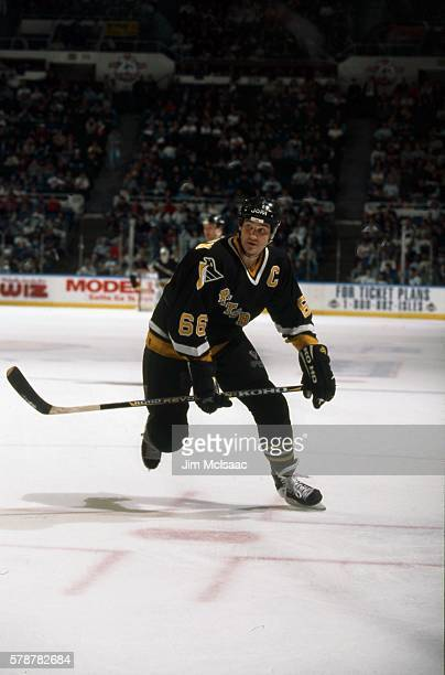 Canadian hockey player Mario Lemieux of the Pittsburgh Penguins skates during a road game, January 1997.