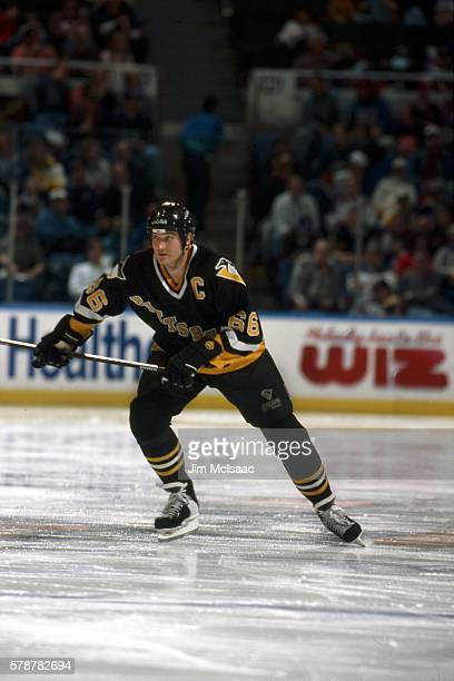Canadian hockey player Mario Lemieux of the Pittsburgh Penguins skates during a road game, February 1997.