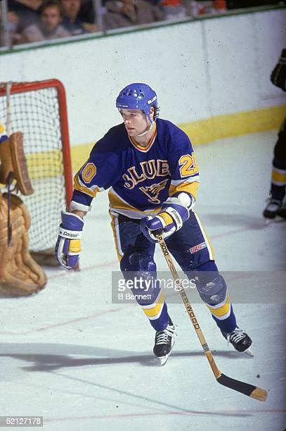 Canadian hockey player Mark Hunter forward for the St Louis Blues skates past the goal during a road game 1986