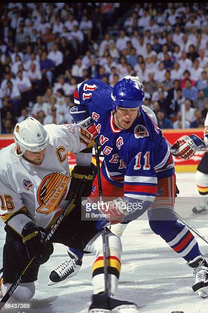 Canadian hockey player Mark Messier of New York Rangers battles with Trevor Linden of the Vancouver Canucks during an unidentified game in the...