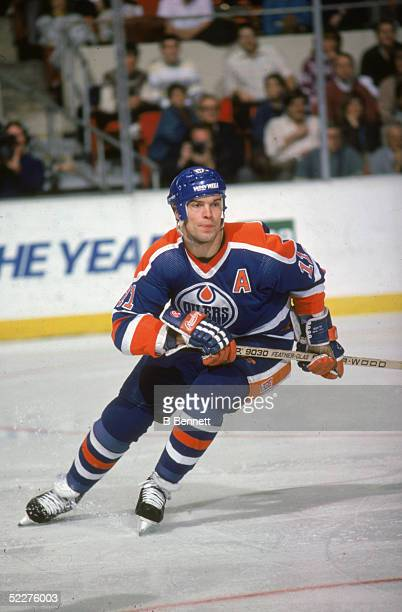 Canadian hockey player Mark Messier of the Edmonton Oilers skates up the ice during a road game against the Hartford Whalers at the Hartford Civic...