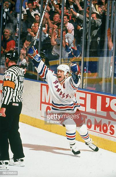 Canadian hockey player Mark Messier of the New York Rangers celebrates his cup-winning goal during game 7 of the Stanley Cup finals against the...