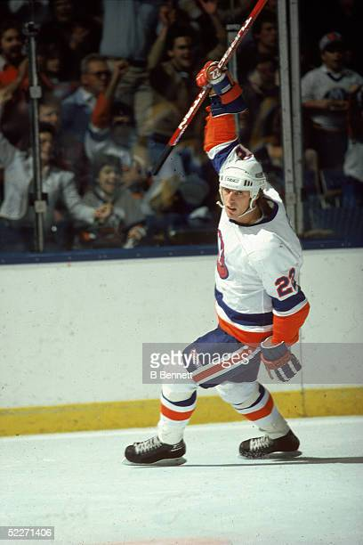 Canadian hockey player Mike Bossy in the uniform of the New York Islanders celebrates a goal during a home game at Nassau Coliseum Uniondale New York...