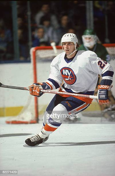 Canadian hockey player Mike Bossy in the uniform of the New York Islanders skates on the ice during a home game against the Hartford Whalers at...