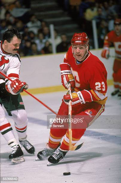 Canadian hockey player Paul Reinhart of the Calgary Flames fights for the puck during a game against the New Jersey Devils East Rutherford New Jersey...