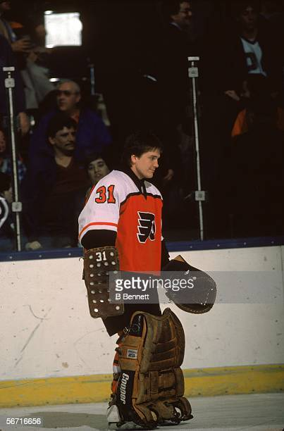 Canadian hockey player Pelle Lindbergh, goalkeeper for the Philadelphia Flyers, skates along the boards during a game at Nassau Coliseum, Uniondale,...