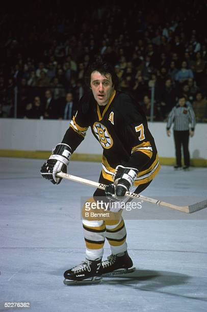 Canadian hockey player Phil Esposito of the Boston Bruins skates with the puck during a road game 1970s