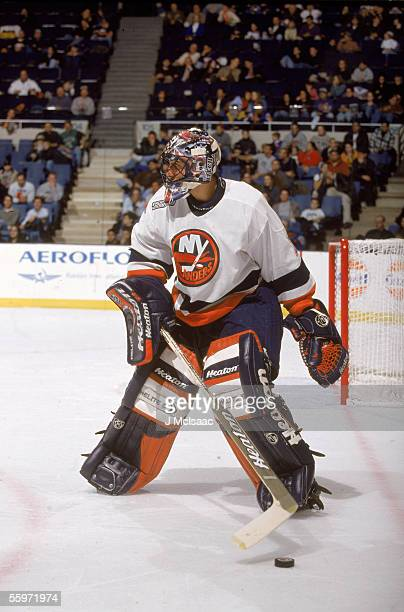 Canadian hockey player Roberto Longo goalkeeper for the New York Islanders takes the puck to the corner December 1999