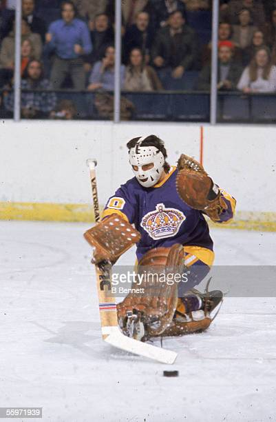 Canadian hockey player Rogatien Vachon goalkeeper for the Los Angeles Kings makes a save 1970s