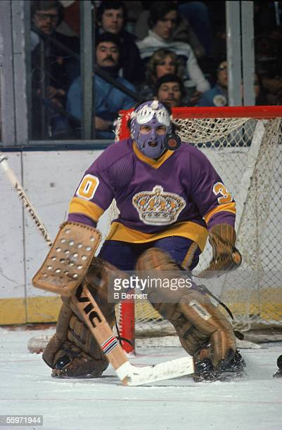 Canadian hockey player Rogatien Vachon, goalkeeper for the Los Angeles Kings, guards the net, 1970s.