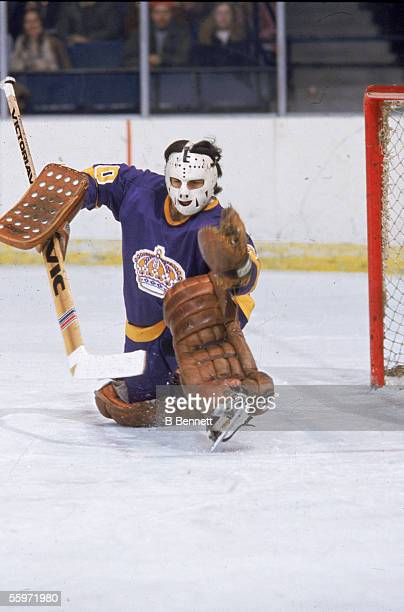 Canadian hockey player Rogatien Vachon goalkeeper for the Los Angeles Kings goes to the ice as he guards the net 1970s