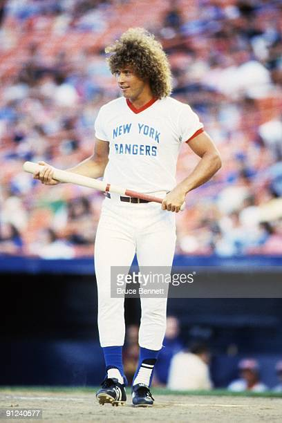 Canadian hockey player Ron Duguay of the New York Rangers walks up to the plate during a celebrity baseball game at Shea Stadium on September of 1982...