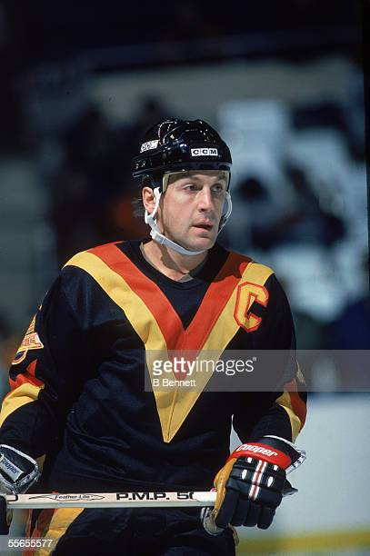 Canadian hockey player Stan Smyl, captain of the Vancouver Canucks, on the ice during a road game, 1980s.