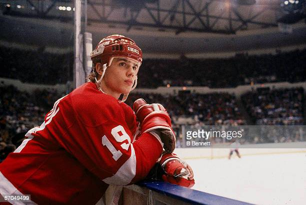 Canadian hockey player Steve Yzerman of the Detroit Red Wings leans on the boards and watches the action during a road game at Nassau Coliseum...