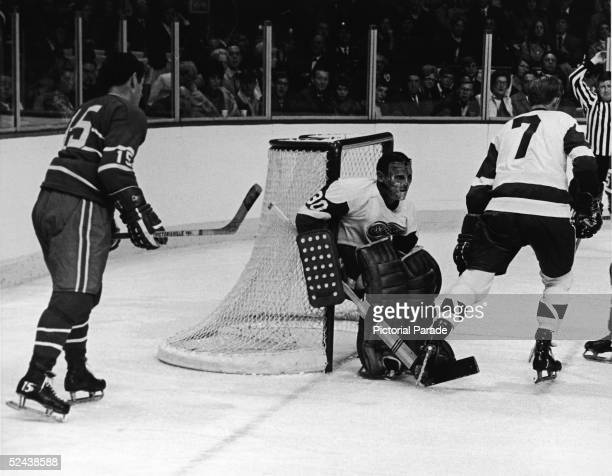 Canadian hockey player Terry Sawchuk goalkeeper for the Detroit Red Wings in action during a game against the Montreal Canadiens early 1960s