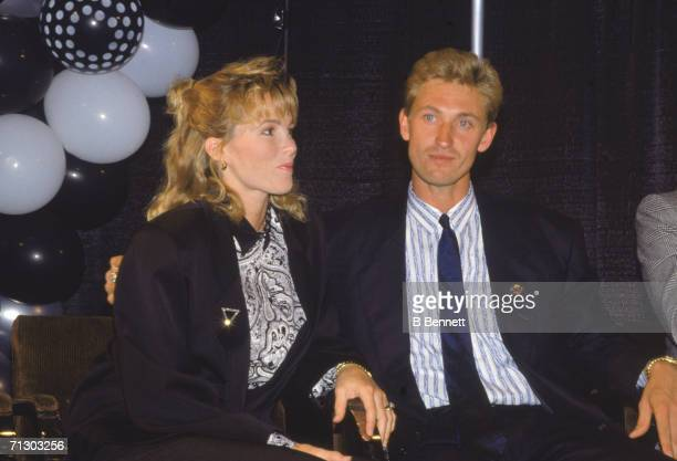 Canadian hockey player Wayne Gretzky sits with his wife American actress Janet Jones at a press conference the announcement that he had been traded...