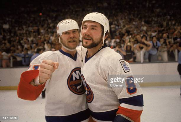 Canadian hockey players Butch Goring and Gary Howatt of the New York Islanders celebrate as the Islanders win their first ever Stanley Cup Nassau...