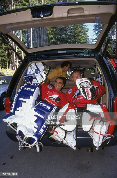 Canadian hockey players Curtis Joseph and Martin Brodeur of Team Canada sqeeze into the hatchback of a car while dressed in full goalkeeping gear at...