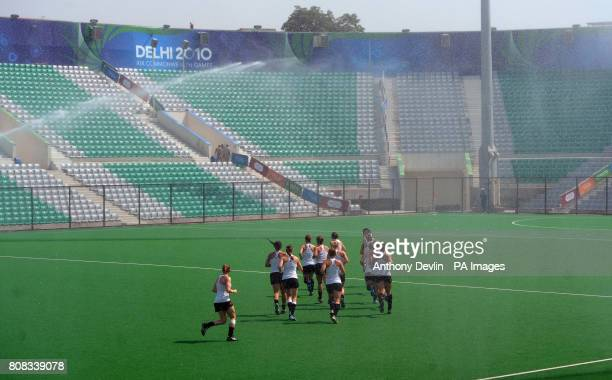 Canadian hockey players warm up inside the Dhyan Chand National Stadium the venue for hockey during the 2010 Commonwealth Games in New Delhi India