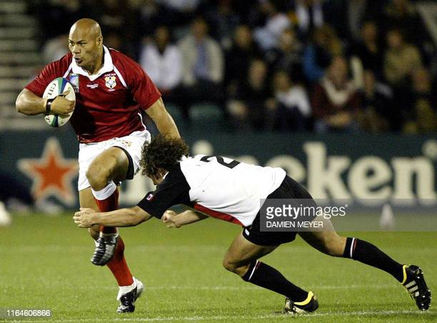 Canadian hooker Mark Lawson tackles Tongan hooker Ephram Taukafa during their Pool D Rugby World Cup 2003 match at the Win Stadium in Wollongong 29...