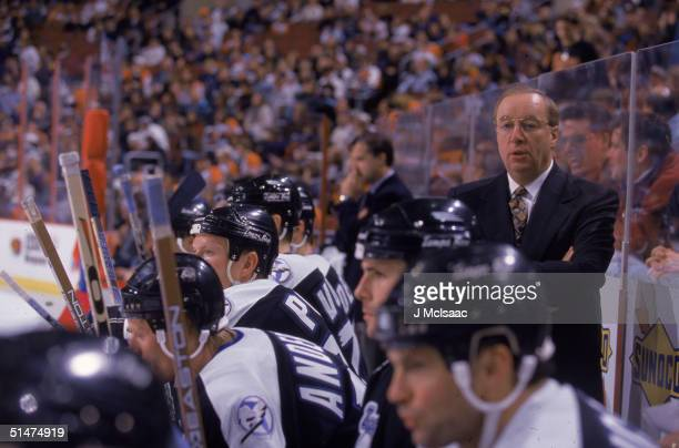 Canadian ice hockey coach Jacques Demers watches the action from behind the bench as his team the Tampa Bay Lightning play at home Tampa Bay Florida...