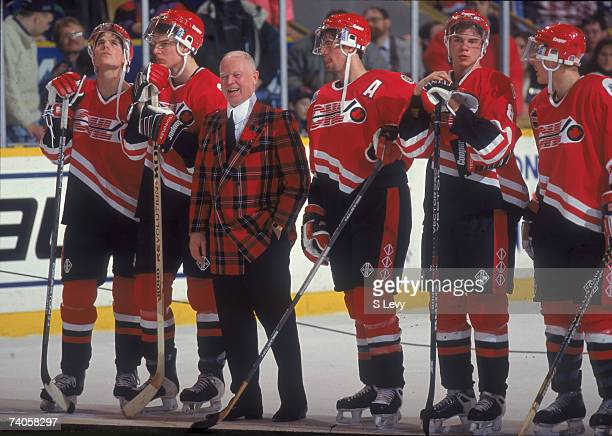 Canadian ice hockey commentator and coach Don Cherry smiles on the ice with members of Team Cherry whom he coached to victory in the Top Prospects...
