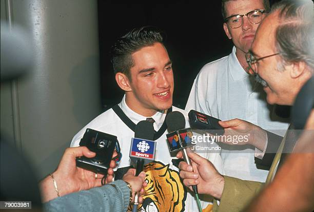 Canadian ice hockey player Alexandre Daigle in a Victoriaville Tigres jersey speaks with journalists at the NHL Entry Draft in le Colisee de Quebec...