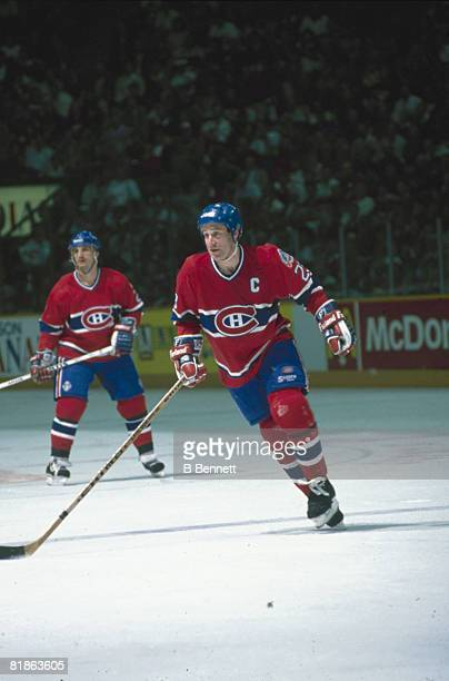 Canadian ice hockey player Bob Gainey of the Montreal Canadiens skates on the ice during a game 1980s Teammate Guy Carbonneau is in the background